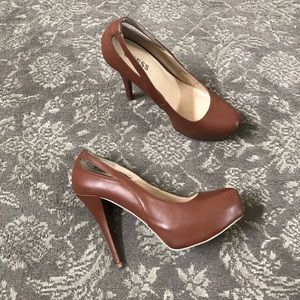 Brown guess heels side cut outs. Size 9